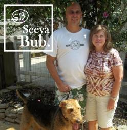 dad-mom-and-lucy-walking-with-sb-logo