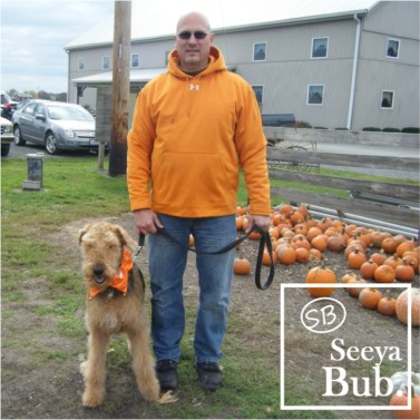 Dad and Lucy Standing at Pumpkin Patch with SB Logo