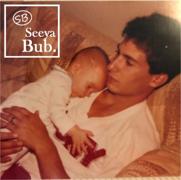Dad Holding Me as a Baby with SB Logo
