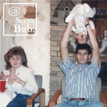 Dad Holding Me Upsdie Down with SB Logo