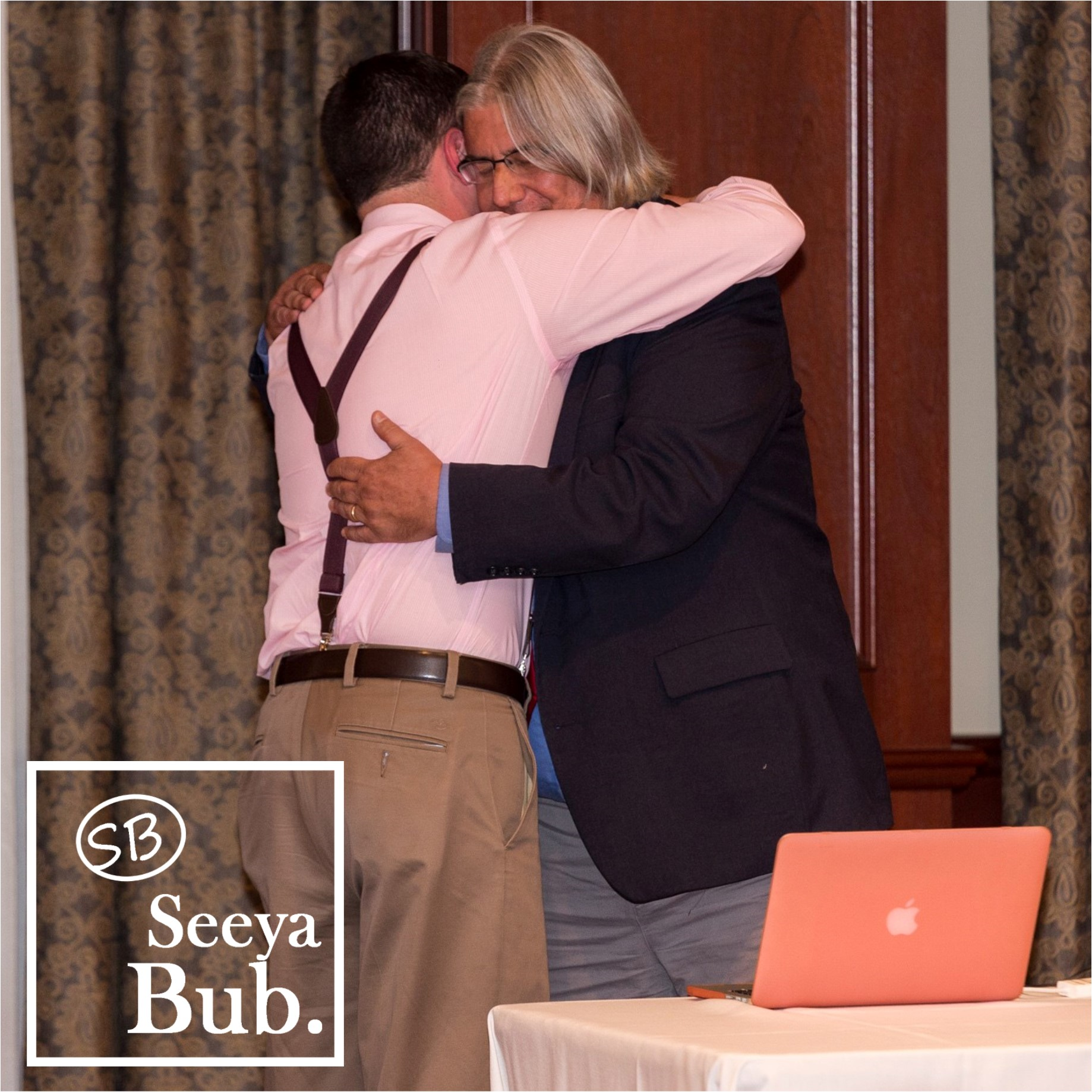 Peter Magolda Hug with SB Logo